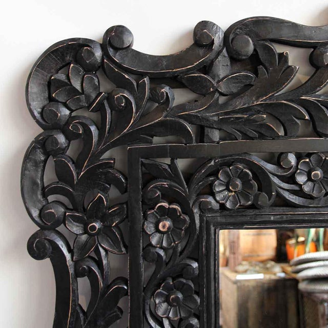 Black carved floral wood mirror. Intricate hand carved detail in a jet black color.