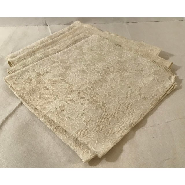 Beautiful set of vintage ecru napkins with a woven floral pattern. Really pretty and will go with any decor!