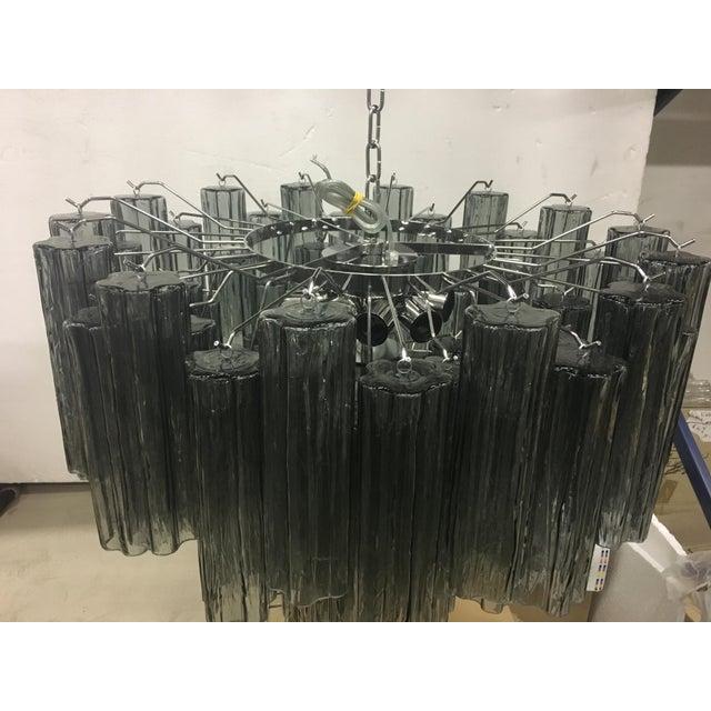 "Impressive and rare contemporary Murano glass ""Tronchi"" chandelier with dark gray Murano glass and a chrome metal frame...."