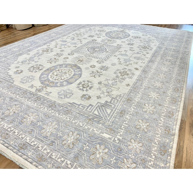 Cool looking Khotan rug in ivory tones field with pale grayish blue border, Hand Knotted, 100% unique transitional Greek...