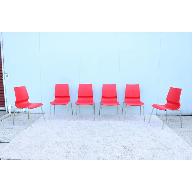 This sleek and elegance Ricciolina chairs are stylish and functional, The distinctive curved connection between the seat...