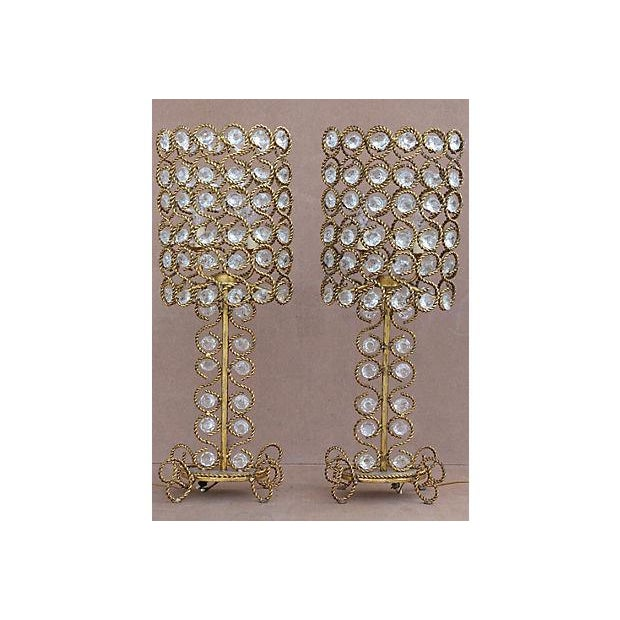 A pair of Italian vintage 1970s table lamps made of rope twist gilt iron frames embellished with crystals. Wired and...
