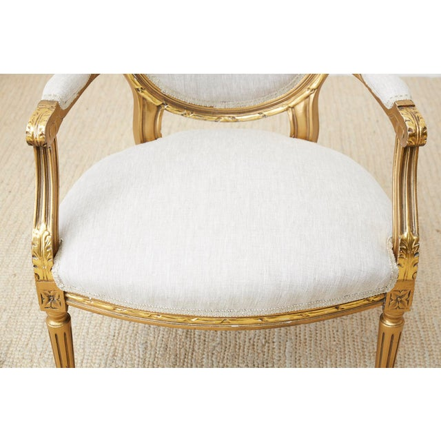 Pair of Louis XVI Style Giltwood Linen Fauteuil Armchairs For Sale - Image 4 of 13