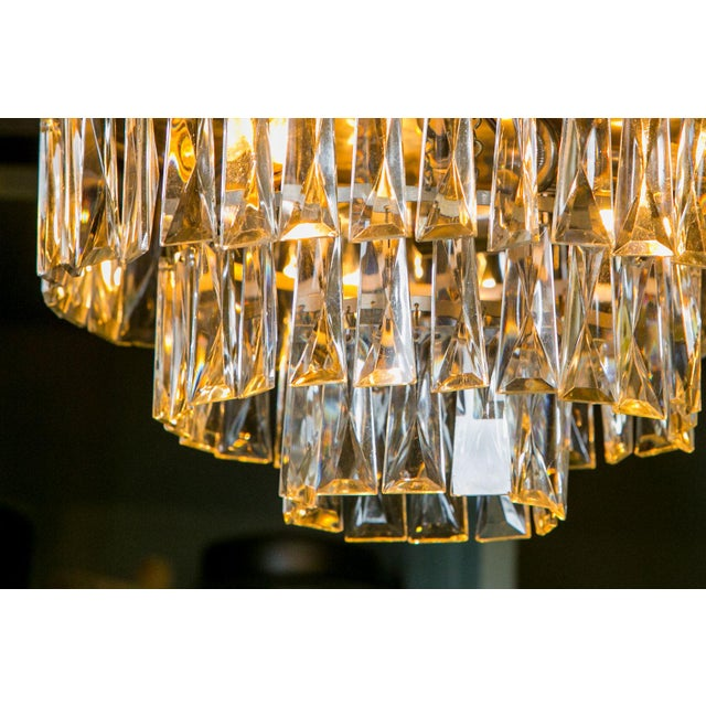 Vintage French chandelier with three tiers of glass prisms. Newly wired for use within the USA. Includes chain and a...
