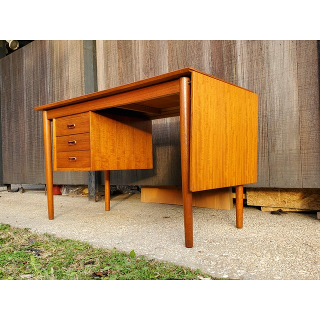 Function meets beauty! A classic Arne Vodder for H.Sigh & Son desk with drop-leaf and sliding rails allow the drawers to...