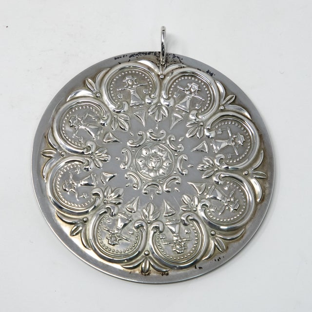 Offering this gorgeous Towle Sterling ornament from 1978. It depicts scroll work and foliate designs to the front with...