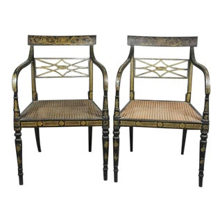 Pair of Regency Ebonized and Gilded Armchairs