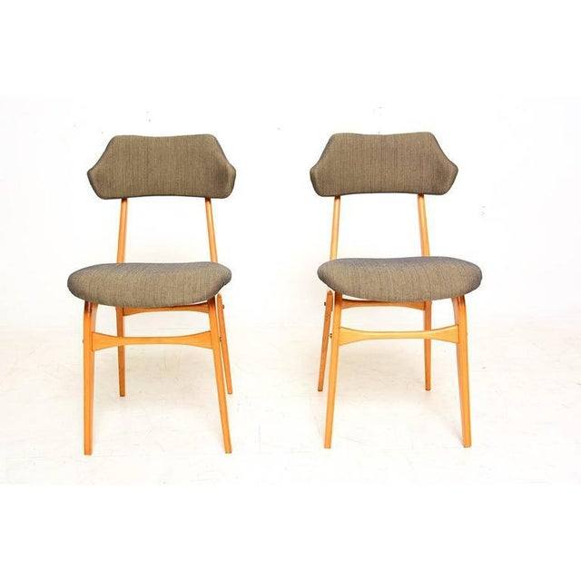 For your consideration a pair of Italian side chairs in the manner of Carlo Mollino. Beautiful sculptural shape. Blond...