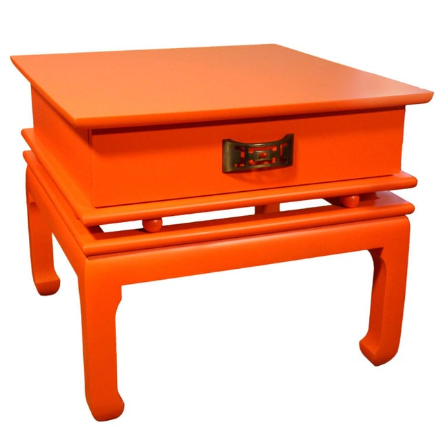 These mid-century painted orange solid wood side tables with drawers have custom solid brass pulls and the Chinoiserie...