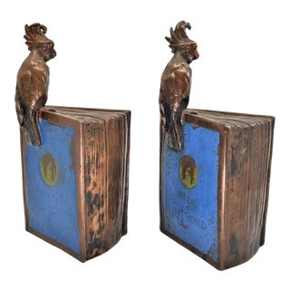 """Art Deco Bronze Clad Crested Parrots on Top of """"Atlas of the World"""" Bookends by Pompeian Bronze - Signed For Sale"""