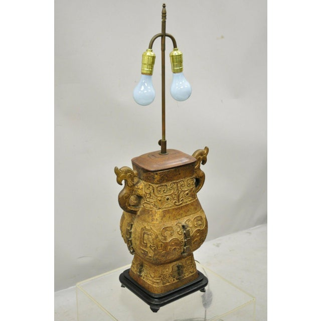 Antique Chinese Gilt Bronze & Rosewood Figural Double Light Table Lamp. Item features etched bronze figural body, rosewood...