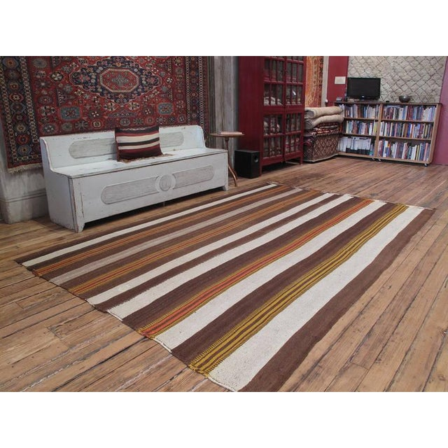 """An old tribal flat-weave from South Eastern Turkey, woven in """"Jajim"""" technique with alternating bands of wool in natural..."""