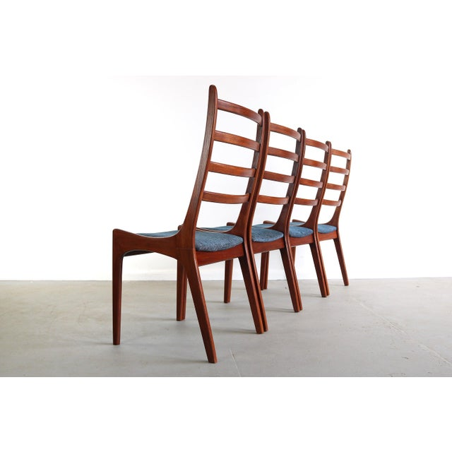 Set of 6 Mid Century Danish Modern Contoured Ladder Back Dining Chairs in Teak by Kai Kristensen These gorgeous chairs...