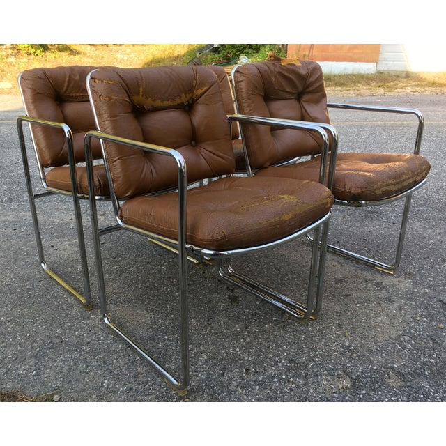 Fabulous form and bones on this set of 4 vintage c.1970's tubular chrome dining chairs by ChromCraft! The chairs would fit...