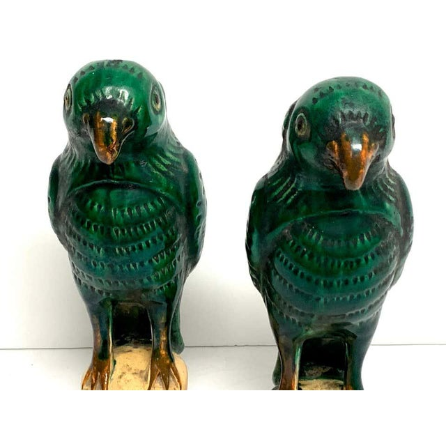 "Pair of Chinese export porcelain green glazed parrots, each raised on an openwork 2.25"" x 2.75"" base. Each parrot measures..."