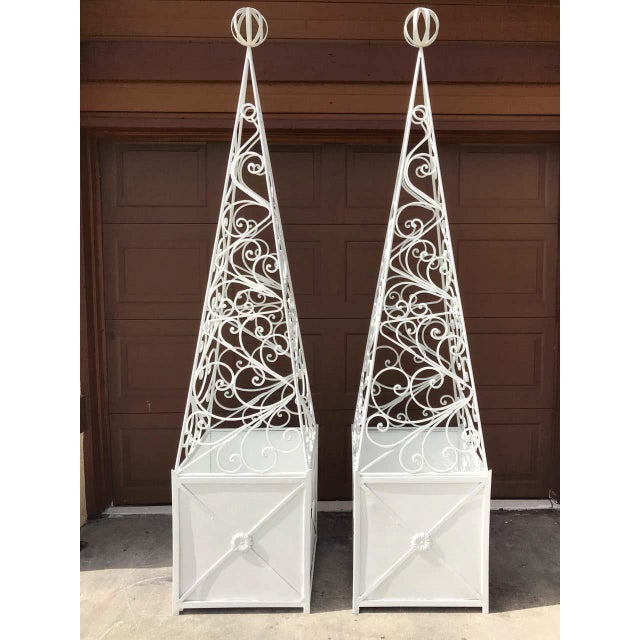 Pair of French Art Deco neoclassical wrought iron obelisk planters, each one of substantial size, in two parts, with...