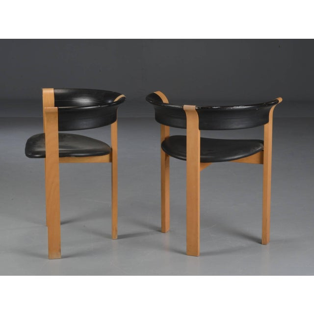 Set of ten model 4551 armchairs by Thygesen & Sørensen for Magnus Olesen with oak frames, black lacquered curved...