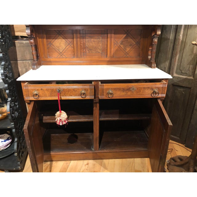 Antique Europe. Victorian Buffet with inlaid burlwood.. 2 drawer with brass pulls and Marble top.
