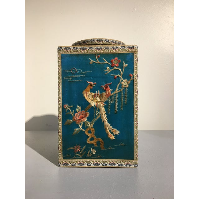 A gorgeous and unusual 1920's chinoiserie tea caddy featuring silk embroidered panels of birds and flowers representing...