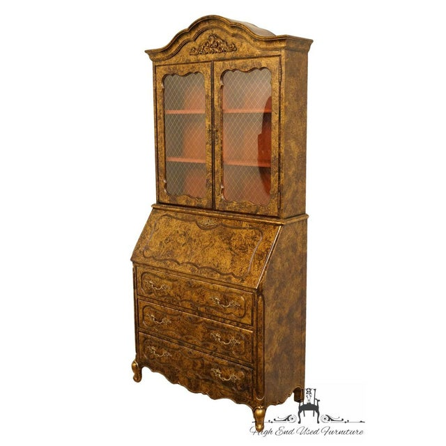 This is a vintage Jasper Cabinet secretary desk from the late 20th century. The piece features a a glass front bookcase...