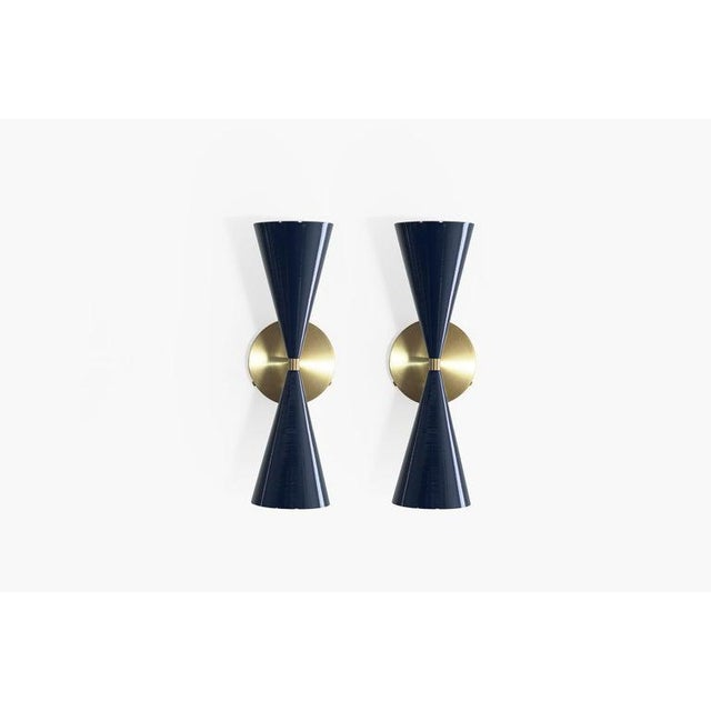 "The ""Tuxedo"" wall mount sconce is strongly influenced by both French and Italian Mid-Century Modernism. Priced as a set of..."