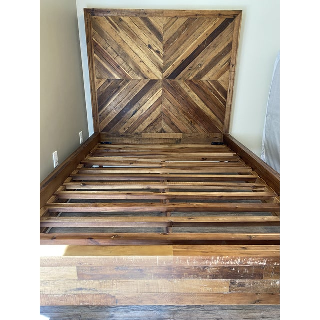 The Alexa Reclaimed Wood Bed (Full) combines sophistication and sustainability with its chevron wood-grain pattern...