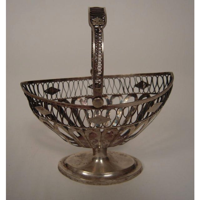 An elegant European coin silver neoclassical style navette-form basket, with cut out diamond decoration and filigree...