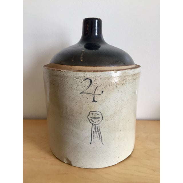 A rare and collectible antique. Heavy, sturdy, 4-gallon stoneware jug; with loop handle. American made in Macomb Illinois,...