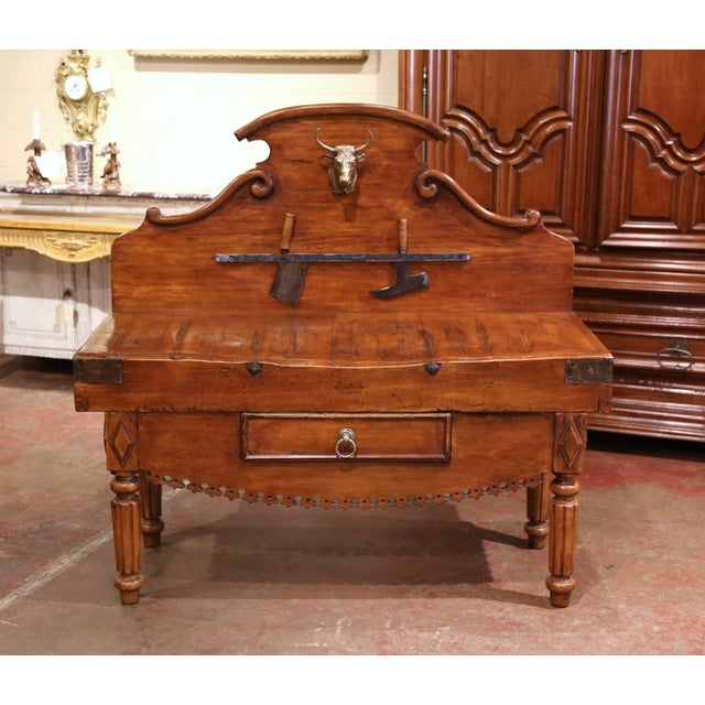 """This antique """"Billot de Boucher"""", or butcher block was crafted in France, circa 1890. The piece stands on fluted and..."""