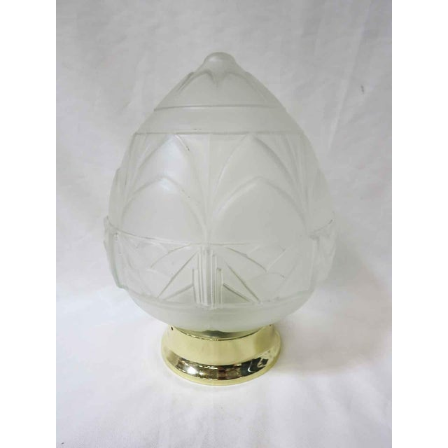 This gorgeous Art Deco Acorn-shaped ceiling glass globe pendant features an embossed high relief geometric detail and a...