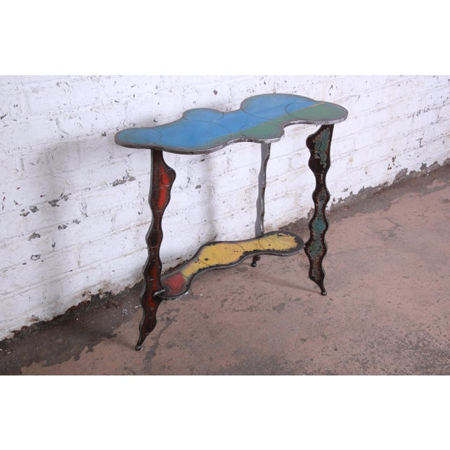 A unique industrial postmodern forged metal console table by notable contemporary furniture designer Cindy Wynn. Extremely...