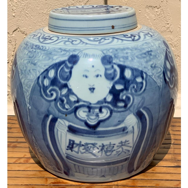 Chinese New Year gift jar with blue and white decoration. This round rice jar is decorated with 4 fat and jolly male...