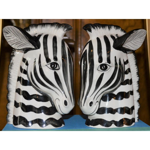 This is a vintage set of Fitz and Floyd zebra bookends. They are incredibly whimsical and a great accent piece in a book...