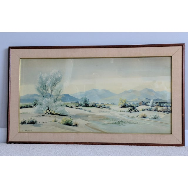 A pair of southwestern watercolors by Evelyn E. McGinnis incased in their original mid-century frames. Artist McGinnis was...
