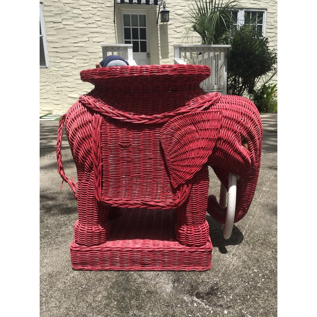 Mid-century red wicker elephant side table with white tusks and red and black eyes. The head shows some wear (could easily...