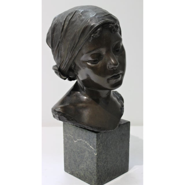 This stylish and romantic sculpture of a young Italian girl dates to the 1880s-1910s and was created by the sculptor...