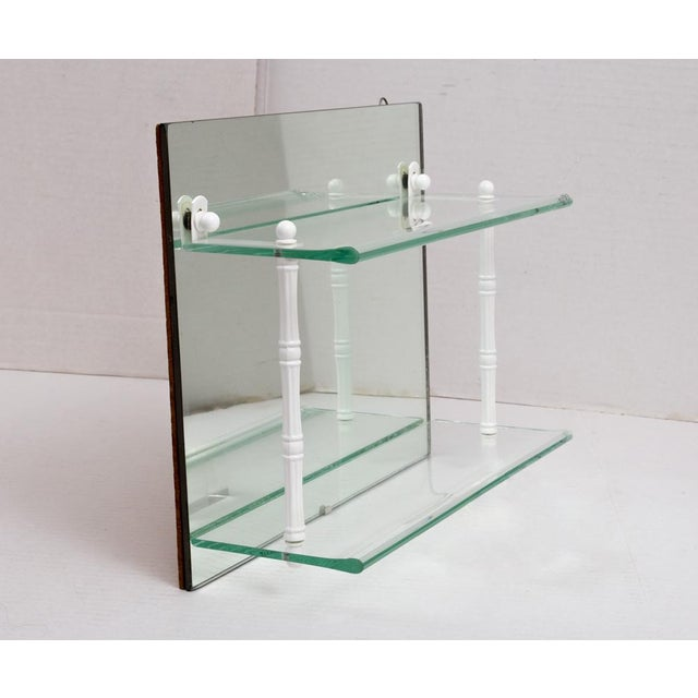 Very nice older vintage two-tier glass shelf unit with a mirror back. Perfect as beautiful storage in a bath, or to...