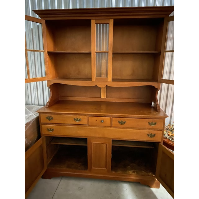 Custom made by Rowley in a workshop in the London area in 1965. Beautiful, solid teak China cabinet/hutch. Two-piece unit....