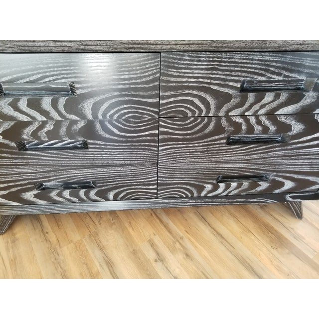 Stunning dresser refinished in a white on black cerruse finish as original I believe this piece is designed by Paul Frankl...