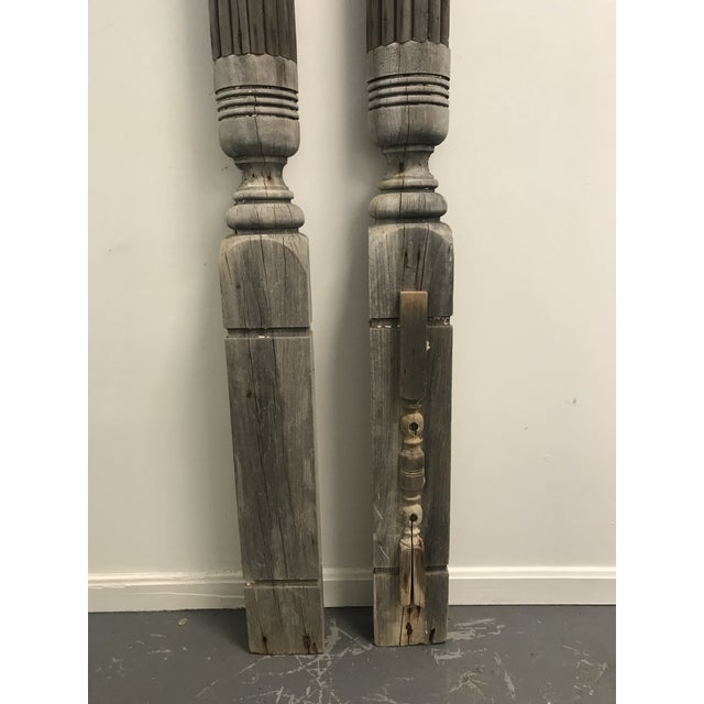 Pair of antique columns with a flat back, perfect for architectual elements against a wall.