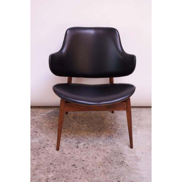 Seymour J. Wiener for Kodawood of Miami, Florida sculptural walnut lounge chair with original black vinyl, circa 1960s....
