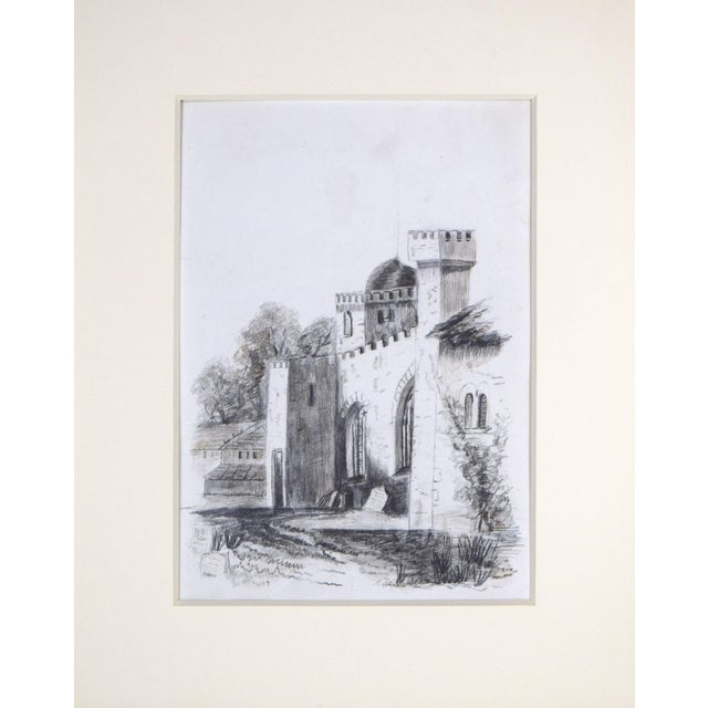 19th Century antique English drawing depicting a castle wall with watch towers. Graphite on paper, presented in cream...