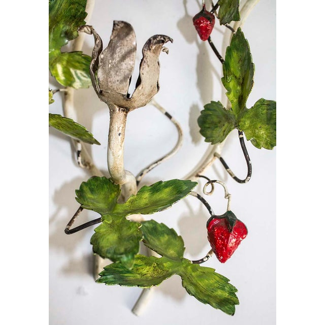 Charming Italian tole sconce showing its age with chippy paint & great patina. The sought after strawberries & leaves...