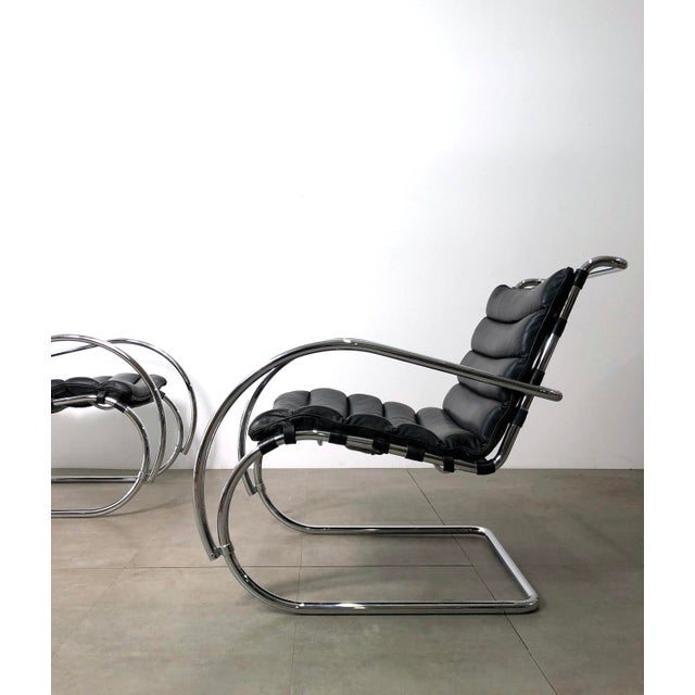 Striking pair of 1970's lounge chairs in the style of Mies Van Der Rohe's MR-40 design for Knoll. Cantilevered frames of...
