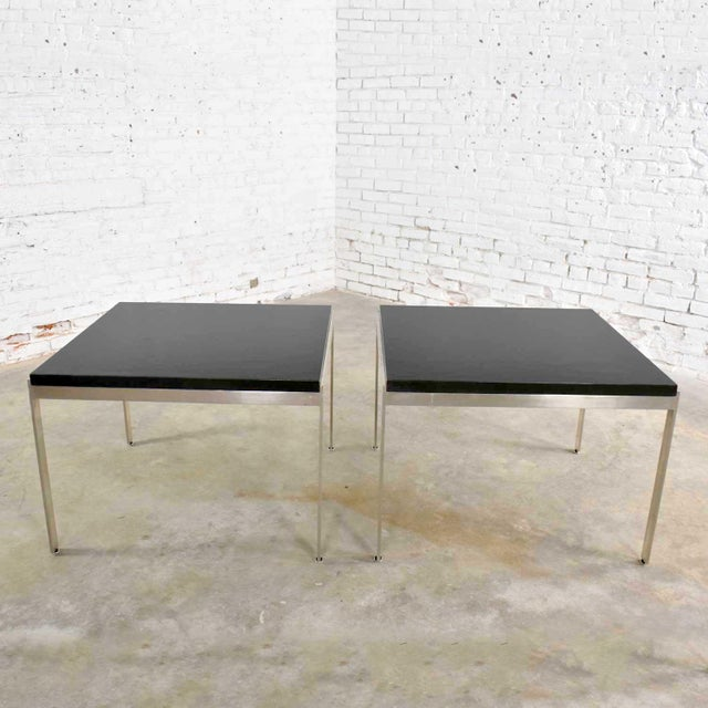 Very handsome pair of stainless steel based large square end tables with black laminate tops. They are in wonderful...