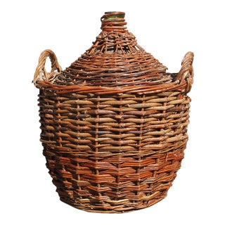 Jumbo French Emerald Green Demijohn Bottle in Woven Grape Vine Basket.