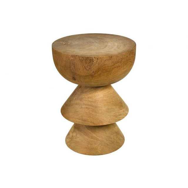 Handcrafted carved wooden stool. Variances in color and size can occur from piece to piece adding to each one's character...