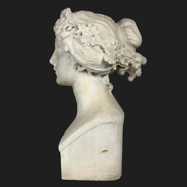 After the Greek Archaic (possibly American sculptor, late 19th-early 20th century) carved white marble bust of the Muse...