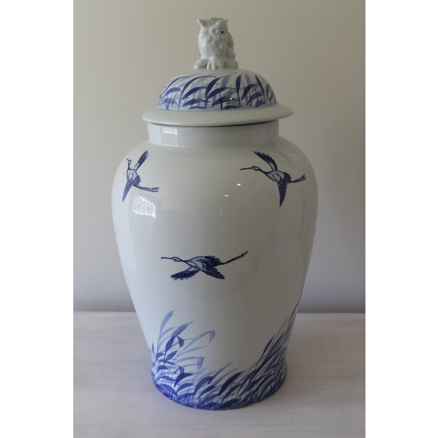 This beautiful Asian urn/ lidded jar, with its serene design, is hand fired with a beautiful semi gloss finish. This...