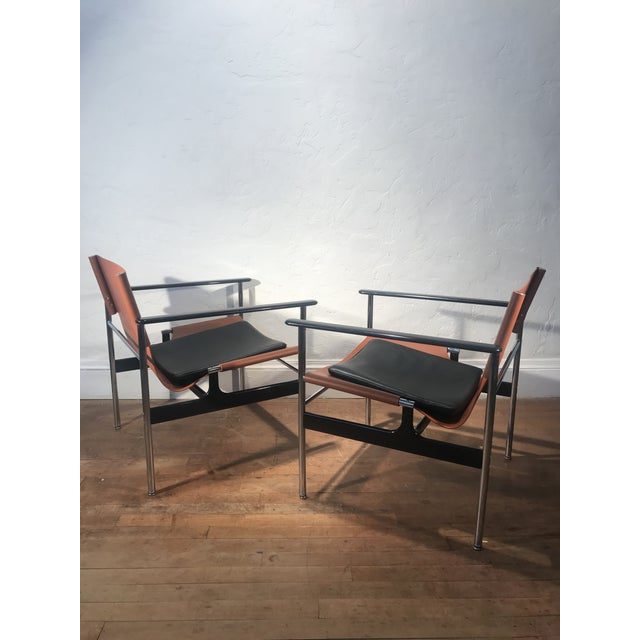 Matching Pair of show room condition Pollock Sling chairs for Knoll. Model 657 Charles Randolph Pollock was an American...